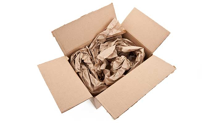 Cardboard box filled with packing paper