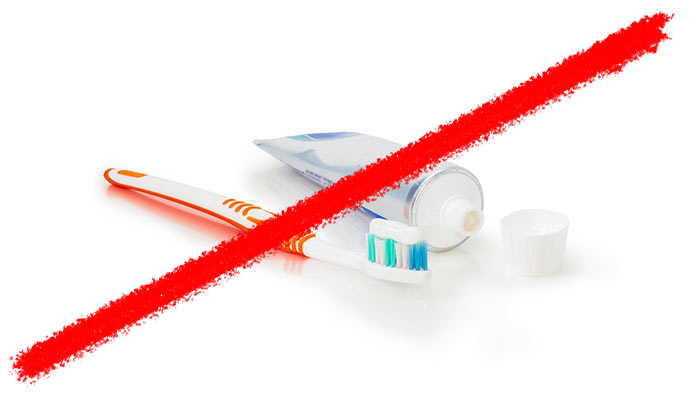 Line striking through tooth brush and tooth paste