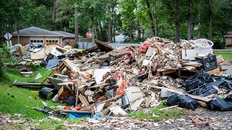 Large pile of debris from a destroyed home.